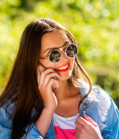 beautiful-emotional-young-woman-in-sunglasses-talking-on-the-phone-soft-background-copy-space-beauty_t20_VL2GR8@2x